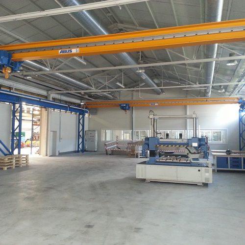 Konstrukcje żelbetowe podsuwnice wraz znadzorem inżynierskim nadjej montażem dla ABUS wzakładach SPINKO, Leszno, 2013
